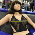"""The """"True Companion"""" sex robot, Roxxxy, on display at the TrueCompanion.com booth at the AVN Adult Entertainment Expo in Las Vegas, Nevada, January 9, 2010.  In what is billed as a world first, a life-size robotic girlfriend complete with artificial intelligence and flesh-like synthetic skin was introduced to adoring fans at the AVN Adult Entertainment Expo.    AFP PHOTO / Robyn Beck (Photo credit should read ROBYN BECK/AFP/Getty Images)"""