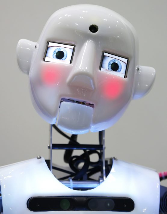 The RoboThespian interactive humanoid robot, developed by Engineered Arts Ltd., stands on display during a demonstration at the International Robot Exhibition 2013 in Tokyo, Japan, on Wednesday, Nov. 6, 2013. The exhibition, hosted by the Japan Robot Association and The Nikkan Kogyo Shimbun Ltd., is held through Nov. 9. Photographer: Kiyoshi Ota/Bloomberg